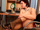 Mature secretary Mila shows her pussy and tits