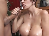 Big titted secretary giving hanjob and taking facial