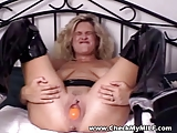 Amateur MILF in PVC with huge dildo