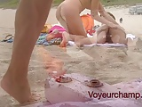 Wives Teasing Nude Beach Voyeurs & Gives One A Handjob!