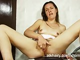 Housewife fingers her pussy instead of doing laundry